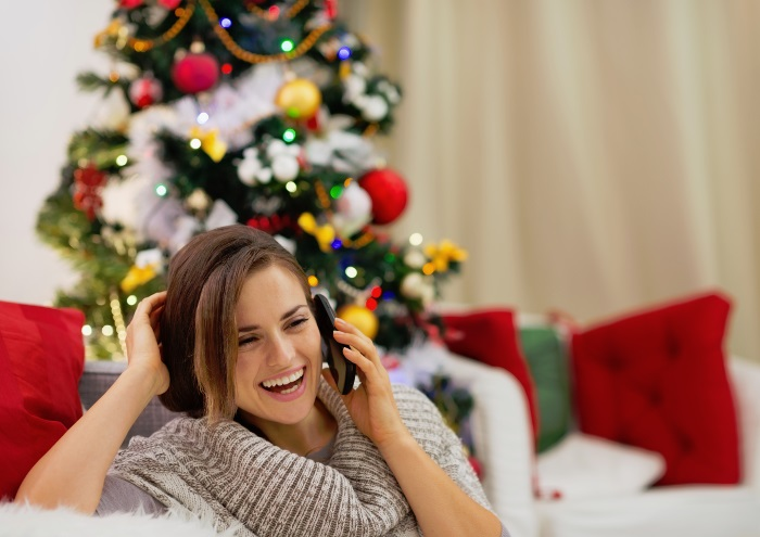 happy-woman-talking-on-phone-at-christmas