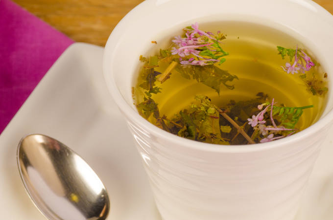 Closeup of a cup containing herbal tea